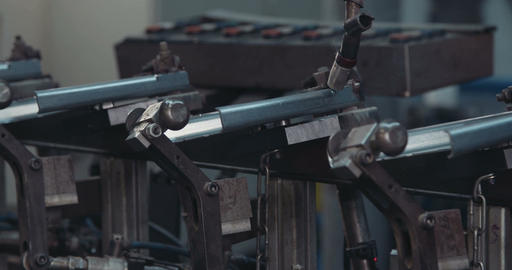 Welding robot manufacturing metal parts for the automotive industry Footage