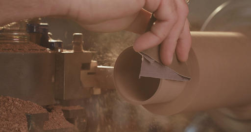 Man working on a wooden lathe creating art objects Footage