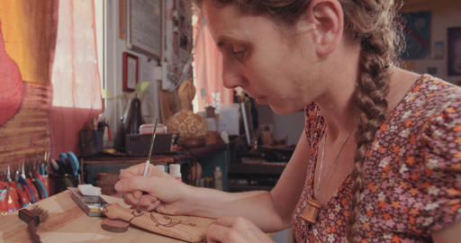 Artist using paint to decorate a buddhist prayer wheel Footage