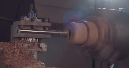 Man using a wood lathe to create wood art objects Stock Video Footage