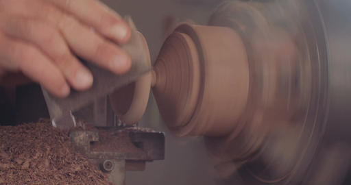 Man using a wood lathe to create wood art objects Footage