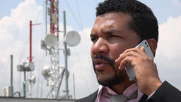 Man Talking On Cell Phone Near Cell Tower Live Action