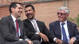 Coworkers Or Business Men Laughing At Joke Footage