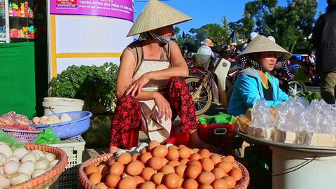 Closeup Woman in Hat Sells Eggs at Street Market in Vietnam Footage