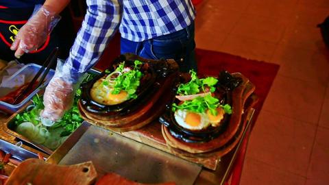 Waiter Puts Greens on Dish Bone Plates in Kitchen in Vietnam Footage