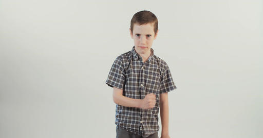 Boy angry and upset on white background Footage