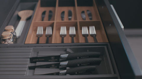 Drawer with silverware in a luxury kitchen Footage