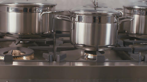 Tracking shot of pots on the stove top in a luxury kitchen Footage
