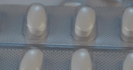 Close up shot of prescription drugs on a reflective surface Live Action