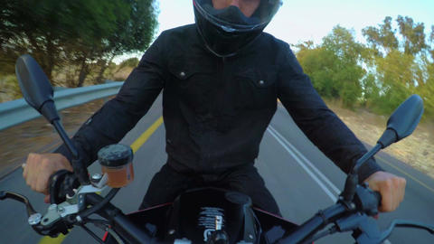 Man riding a sport motorcycle at high speed on a curved countryside road Footage