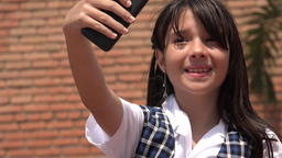 Cute Girl Taking Selfies With Cell Phone Live Action