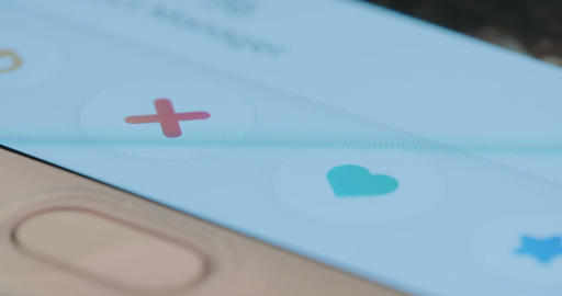 Macro shot of browsing through a dating app on a... Stock Video Footage