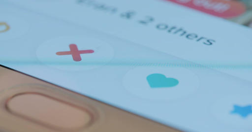 Macro shot of browsing through a dating app on a smartphone screen Footage