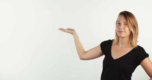 Young beautiful blonde woman presenting information on white studio background Footage