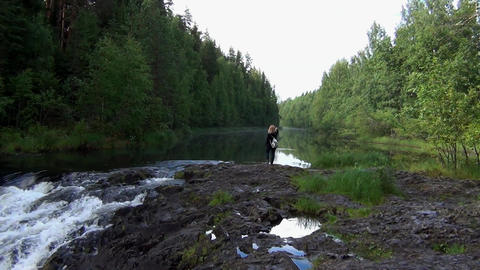 Woman taking pictures of river landscape Footage