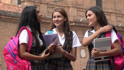 Female Students With Textbooks And Backpacks Live Action