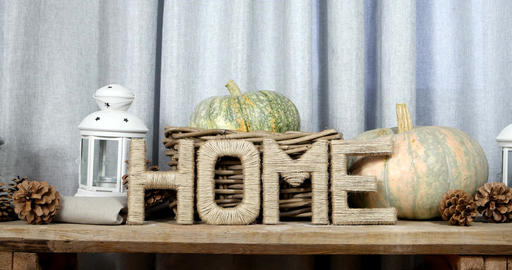 Letters drawn up in the form of the word HOME with pumpkins, pine cones and lant Footage