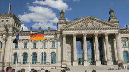 German flag and The Reichstag (government) building in Berlin Footage