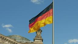German flag on The Reichstag building in Berlin Footage