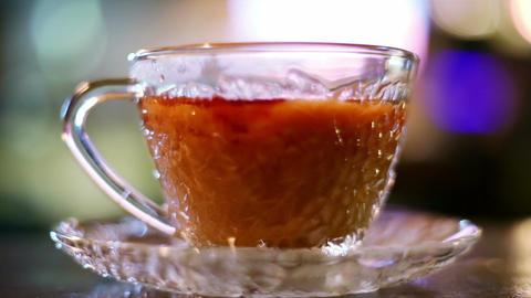 Pouring milk into hot black tea, milk spills Footage