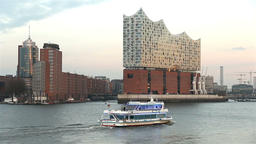 Elbphilharmonie in hamburg, germany in sunset with elbe river and tourist boat 2 Footage