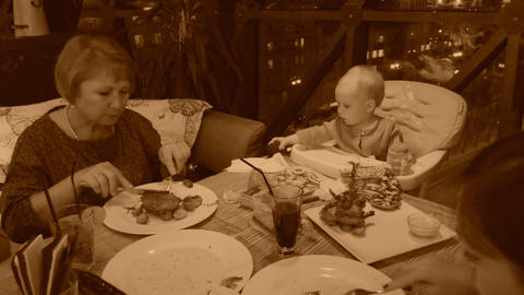 Family in restaurant, old style sepia view with grain ビデオ
