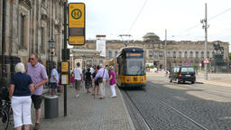 Tram stop next to Theaterplatz in Dresden, Germany. City life Live Action