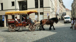 Horse cab and tourists on the street of old town in Dresden, Germany Footage