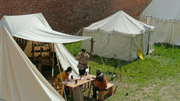 Medieval people in medieval encampment under the walls of the castle Footage
