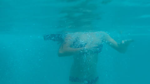 Young woman swimming underwater Footage