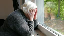 Sad, broken and depressed senior woman Footage