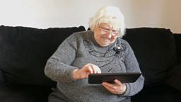 Old, senior woman and tablet computer Live Action