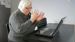 Old woman and computer. Winning in online gambling or solving computer problem Footage