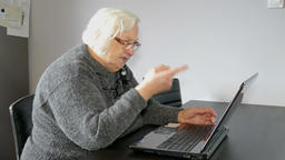 Old woman warns the online interlocutor or computer. Funny Footage