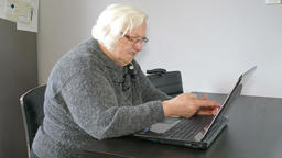 Angry old woman warns the online interlocutor or computer. Funny Footage