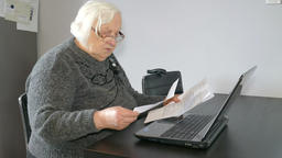 Old woman is checking her bills or taxes Footage