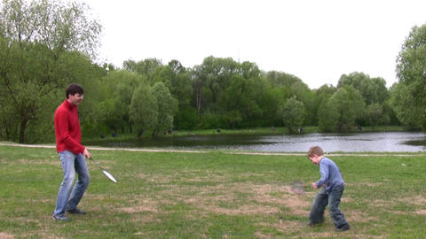 father with son play badminton Footage