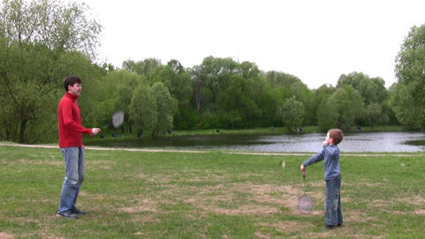 father with son play badminton Stock Video Footage