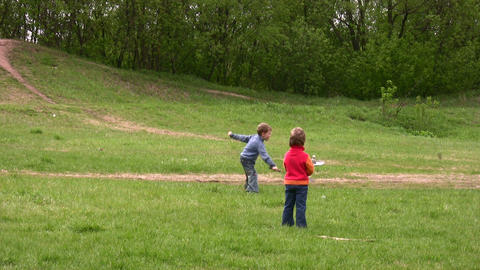 children play badminton Stock Video Footage