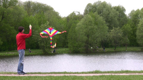 man with kite in park Footage