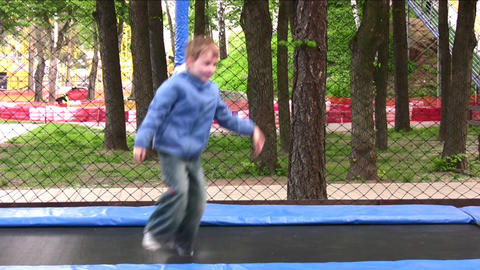 child on trampoline Footage