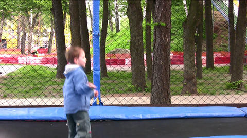 child on trampoline Stock Video Footage