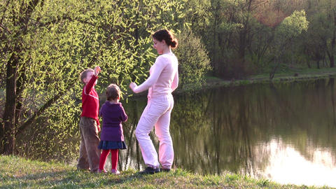 mother with children on spring pond Stock Video Footage