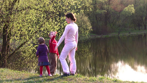 mother with children on spring pond Footage