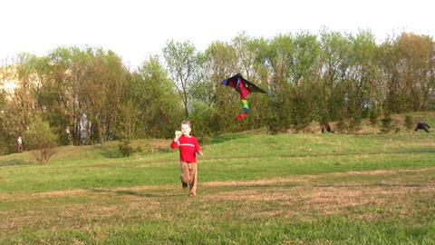 boy run with kite Stock Video Footage
