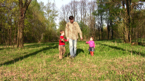 father with children in park Stock Video Footage
