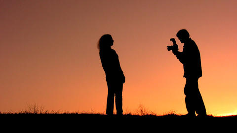 couple make photo sunset Stock Video Footage