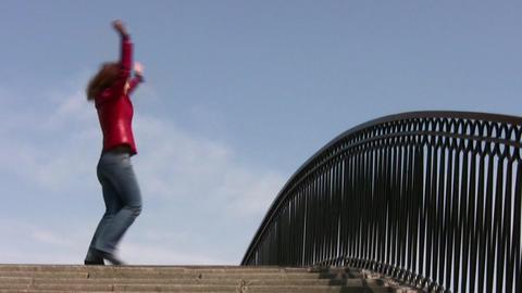girl dance on bridge Footage