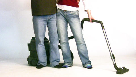 couple with vacuum cleaner 2 Stock Video Footage