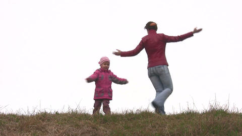 mother with child play on meadow Footage